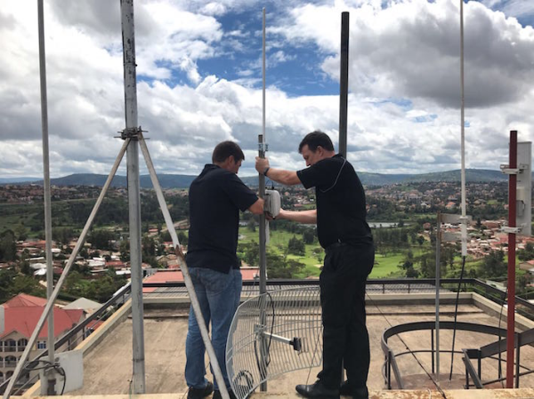 Engineers setting up Kigalis' smart city LoRaWAN network.