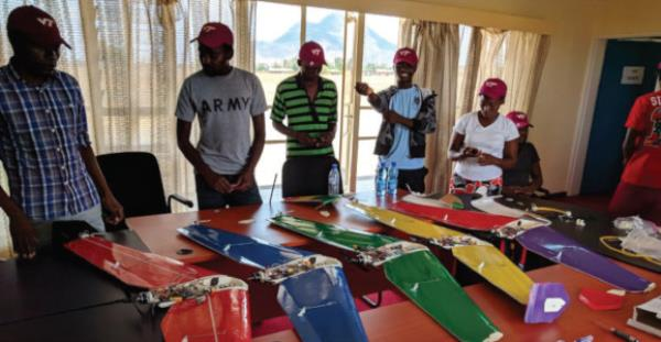 A group of 13 students from Malawian universities make drones from foam core (plaster board) and 3D printed parts
